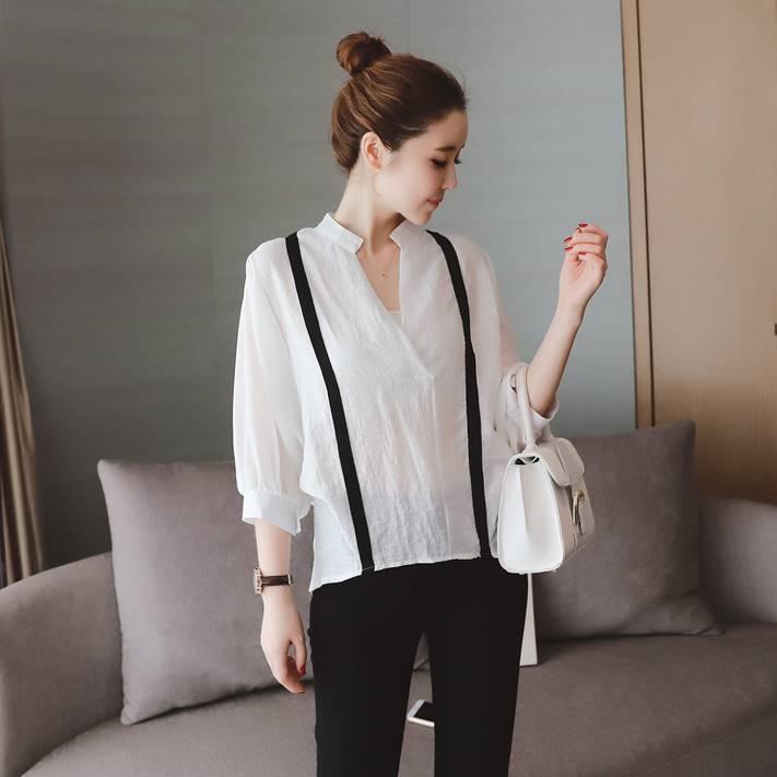 เสื้อแฟชั่น คอวี แขน4 ส่วน ผ้า polyester สีขาว