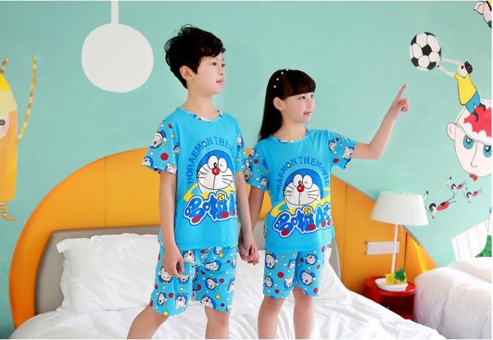 ชุดนอนเด็กโตสีฟ้า ลายโดเรมอน ชุดแขนสั้นขาสั้น ผ้าดีใส่สบายน่ารักมากๆค่ะ