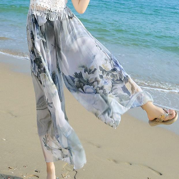 กางเกงขายาวแฟชั่นชายทะเล ลายดอกไม้สีม่วงอ่อน (2017 Korean version of the resort beach wide leg pants chiffon seven nine pants skirt pants straight was thin thin female pants)