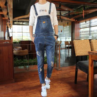 ชุดเอี้ยมยีนส์กางเกงขายาว สีน้ำเงิน แต่งกระเป๋าด้านหน้า